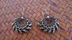 Magatama earrings.