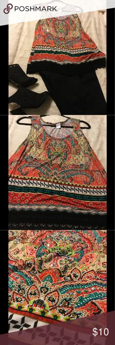 Ladies multi-colored sleeveless shirt Beautiful ladies sleeveless shirt  with black embroidery around the bottom and sequins scattered throughout. Looks great with black dress pants or with jeans. Add a black cardigan and wear it to work! Bila Tops Camisoles