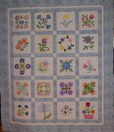 Donation Quilt for Grace Community Church, March 2016. Members of Quilt Guild by the Sea made these flower blocks, I assembled the quilt, Linda A quilted it.