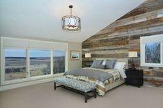 Bedroom with wooden walls