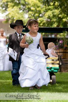 country western wedding www.candidapple.ca john deere wagon cowboy ring bearer