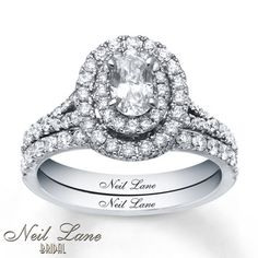 This classic engagement ring from the Neil Lane Bridal® collection showcases an exquisite 1/2 carat oval diamond encircled with two rows of round diamonds. Additional round diamonds line the band and the matching wedding band to complement. The total diamond weight of this fine jewelry bridal set is 1 1/2 carats. Neil Lane rings are handcrafted and undergo a four-step polishing process to give each ring its beautiful shine and luster. The Neil Lane signature appears on the inside of both 14K…