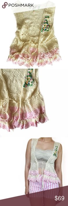 • Free People • Crochet Vest Gorgeous knit crochet vest with gorgeous floral detail. Achieve that traditional effortless bohemian look with this trendy piece! Free People Jackets & Coats Vests
