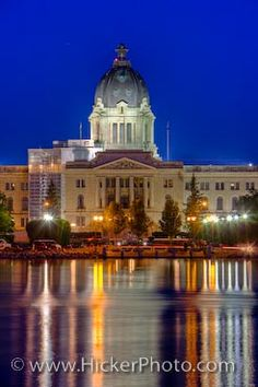 Picture: The night lights which surround the Legislative Building in the City of Regina in Saskatchewan, Canada reflect across the surface of Wascana Lake. Great Places, Places Ive Been, Beautiful Places, Landscape Lighting, Landscape Photos, Largest Countries, Capital City, Saskatchewan Canada, City Photo