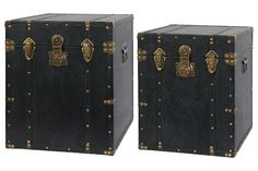 Two decorative leather trunks with brass fixtures and rivits.