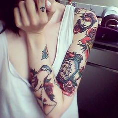Nice traditional tattoos... ship in a bottle... lower arm?
