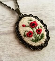Red poppy Embroidered Pendant Necklace This listing is for 1 necklace with embroidered pendant Vintage style handmade embroidered jewelry. Basic fabric is wool felt. Pendant: Finding is bronze bras…