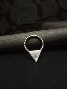 This seriously sharp arrowhead. | 21 Unconventional Septum Rings That You Need Immediately