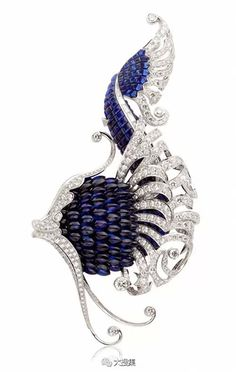 Van Cleef & Arpels, from their L'Atlantide collection - Illiade clip - a beautiful design using sapphires and diamonds