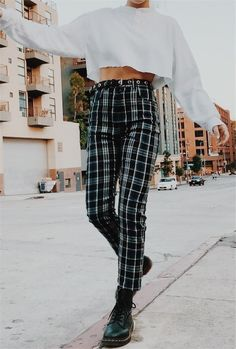 480bbb3fcd6 high rise checkered pants with a grey sweater crop top and combat boots.