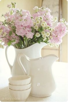 white pitchers ~ beautiful flowers ... perfect combination!  Sometimes simple is just best!