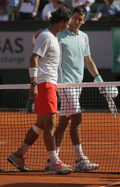Spain's Rafael Nadal, left, and Serbia's Novak Djokovic hug after their semifinal match of the French Open tennis tournament at the Roland Garros stadium Friday, June 7, 2013 in Paris. (AP Photo/Michel Spingler)