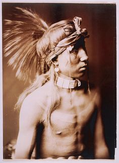 [Shows As He Goes, half-length portrait] c1905. Curtis, Edward S., 1868-1952, photographer.