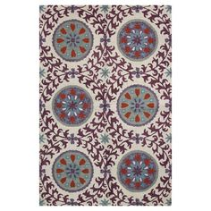 Create an exotic focal point in your living room, foyer, or den with this hand-tufted wool rug, showcasing a suzani-inspired medallion motif.