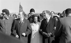 Mrs. Coretta Scott King, widow of the civil rights leader Martin Luther King Jr., is flanked by Sens. Charles E. Goodell, left, and George S. McGovern, right, while marching in Washington, D.C.,  Nov. 15, 1969. A longtime advocate for ending the Vietnam War, McGovern joined thousands as part of the moratorium marchers on the National Mall. Southern Christian Leadership Conference, Black King And Queen, Coretta Scott King, Civil Rights Leaders, Historical Women, African American History, Martin Luther King, Black History Month, Vietnam War