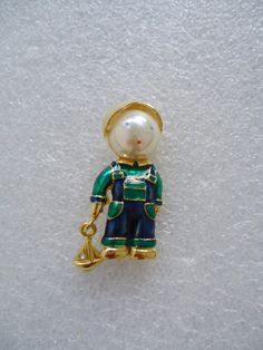 Check out this item in my Etsy shop https://www.etsy.com/listing/222913793/vintage-gold-tone-little-boy-with