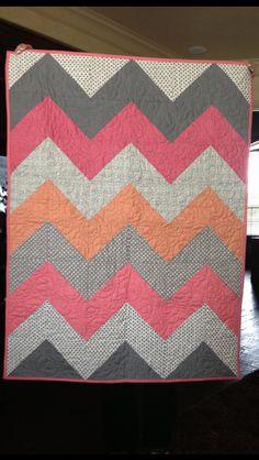 Chevron quilt for baby girl nursery.