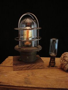 Rodger Thomas' upcycled products are soooo cool.....  Upcyled Solid Brass Nautical Marker Lamp by BenclifDesigns on Etsy