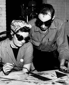 96fb036039 Man training woman in welding as part of national defense program. -- WWII  propaganda photograph (USA)