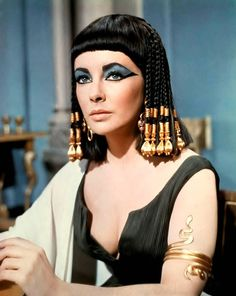 How  awesome is Elizabeth Taylor's iconic look from the film Cleopatra. Her blue eyes, blue eye shadow, jet black hair and oh the gold!