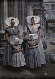 Bold Bonnets In this November 1931 autochrome by Wilhelm Tobien, two women from the Netherlands' Zeeland province pose with their daughters. Their fan-shaped bonnets are hallmarks of the region's folk costume.