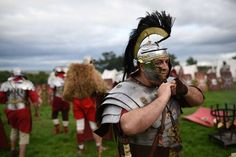 Re-enactor's portraying soldiers from the Imperial Roman Army prepare for battle. (Oli Scarff/AFP/Getty Images)