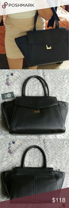 Authentic Vince Camuto Leather Satchel Classy and chic black Vince Camuto leather satchel, brand new never used. Includes dust bag Vince Camuto Bags Satchels