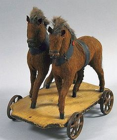 Cloth and Wood Horse Pull-toy, the two brown horses with manes and black canvas accents on a wheeled platform