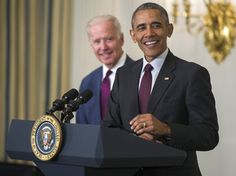 U.S. President Barack Obama, joined by Vice President Joe Biden, share a laugh as Obama delivers remarks at the Easter Prayer Breakfast at the White House.