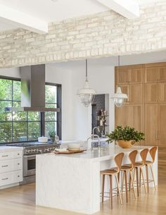 White brick grey brick wood cabinets island