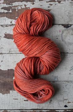 Hand-dyed with madder root and logwood in a vibrant, fiery red with subtle silvery highlights.