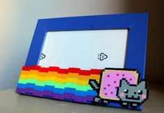 Nyan Cat Picture Frame perler fuse beads by BeadxBead Nyan Cat, Pearler Bead Patterns, Perler Patterns, Unique Photo Frames, Picture Frames, Cat Coasters, Diy Perler Beads, Beads Pictures, Fuse Beads
