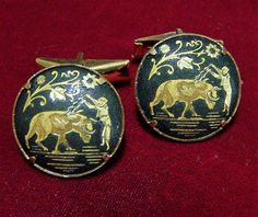Vintage Damascene figural cuff links Detailed bull fighter spearing bull during fight Black and gold tone Unsigned 7/8 inch diameter round Good vintage condition, shows no wear International buyers welcome, over charges are automatically refunded Please visit my mens jewelry section for more cuff links Priority shipping is optional 20817  Credit cards and Paypal accepted