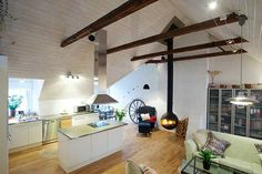 Stockholm kitchen -- love the malm-style fireplace.