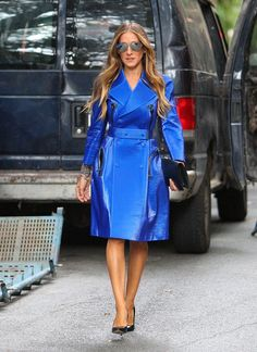 Sarah Jessica Parker stood out in the crowd at today's @CalvinKlein fashion show: #SJP Shimmering Statement Coat at #NYFW . The actress puts a ladylike spin on outerwear.