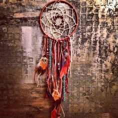 It's extremely hard to describe how to make a dreamcatcher so I tried my best to snap photos to help illustrate the steps I took. I may have gotten carried away with the photos, but better too many than too little! Have any questions, please ask! :)SUPPLIES:One large metal ringDeerskin…