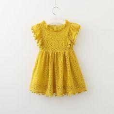 2eaf109ba17 Toddler Girl Lace Dress with Flutter Sleeves and Pom Pom Trim. Noah s  Boytique