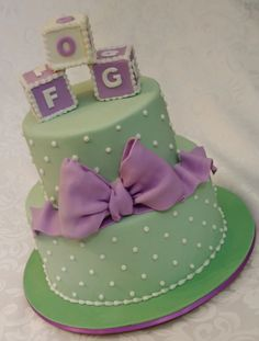Green/Purple baby shower cake - i like it all but the blocks..