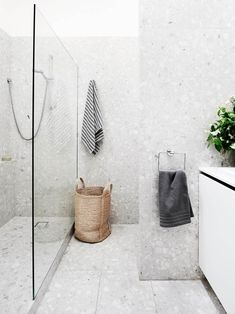Modern Renovation Of A Melbourne Townhouse In the bathroom, the existing shower cubicle was converted into a laundry area and a new walk-in shower installed. In keeping with the home's sensibilities, terrazzo tiles were laid from floor to ceiling. Grey Bathrooms, White Bathroom, Bathroom Interior, White Shower, Modern Bathroom, Minimal Bathroom, Neutral Bathroom, Room Tiles, Bathroom Floor Tiles