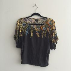 Dark Grey short sleeve top w floral detail Anthropologists: dark great short sleeve top with butterfly sleeves. Slightly cropped, and loose-fitting, this is the perfect spring top. Very comfy and in good condition! Anthropologie Tops Tees - Short Sleeve