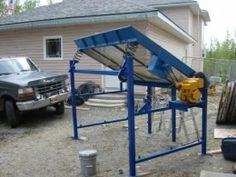 Rock Separator - Homemade rock separator constructed from surplus components including: a 5hp gasoline engine, vibratory bearings, and expanded screen sourced from a lumber rack.