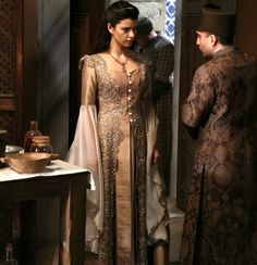 Kosem sultan's peach dress with sparkling lace