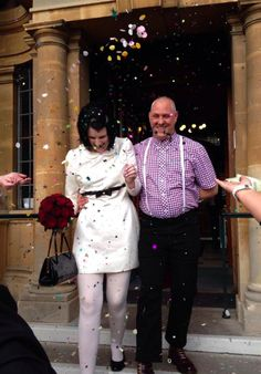 Vicky's awesome MOD themed wedding wearing ChantelleSophia 60's cream and black wedding dress.