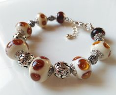 Handmade Beaded Lampwork Bracelet with ivory and amber glass Tiny Necklace, Glass Necklace, Necklaces, Handmade Beads, Amber Glass, Gifts For Wife, Bracelet Making, Glass Beads, Cuff Bracelets