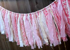 Banner made out of fabric scraps tied onto rope. Wanna do this with lace, burlap, and blue jean scraps to make it more rustic looking.