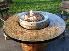 A patio fire for wine lovers. Wine Barrel Fire Pit Table with cork top. Very unique!