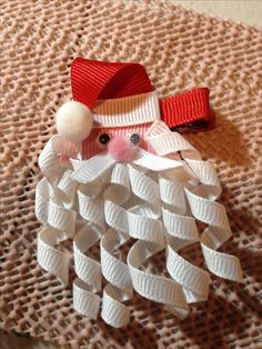Cute sculptured ribbon bow of Santa. No instructions, but great picture. Should be able to figure this one out.
