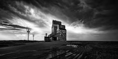 Liberty by Sandra Herber The lovely old grain elevator in Liberty, Saskatchewan. As I arrived to photograph this beauty, the skies opened, it poured and I thought I wasn't going to be able to get a. Canadian Prairies, Great Names, More Images, Tower Bridge, Google Images, Liberty, Sky, Windmills, Elevator