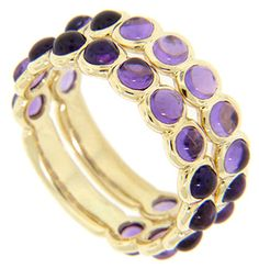 Cabochon purple amethysts are set three quarters of the way around these 14K yellow gold stackable wedding bands. The rings' scalloped edges mirror the curve of the set stones. Each band measures 4.1mm in width. Size: 6. We can resize. The bands are frequently purchased as a set for $620.00 but they are also available individually for
