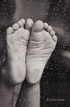 """Through glass and rain and mooshed up, her feet are still so cute.""  Sheye Rosemeyer - Flickr"